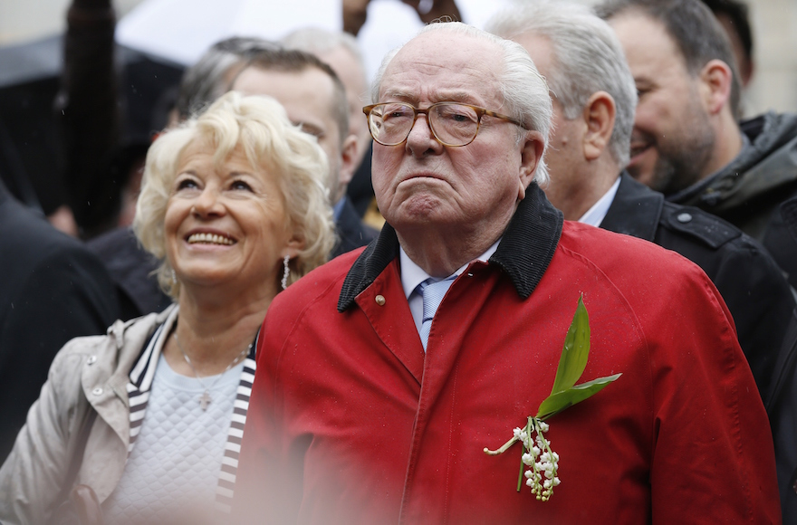 French far-right party Front National founder and honorary president Jean-Marie Le Pen looking on at the foot of a statue of Joan of Arc during the party's annual rally in honour of Joan of Arc in Paris, May 1, 2015. (Thomas Samson/AFP/Getty Images)