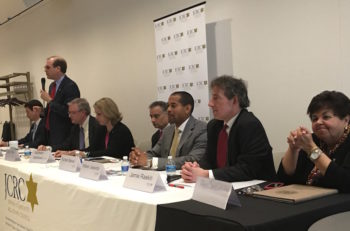 Left to right: Congressional candidates Joel Rubin, David Anderson (standing), David Trone, Kathleen Matthews, State Del. Kumar Barve, Will Jawondo, State Sen. Jamie Raskin and State Del. Ana Sol Gutierrez debate in Rockville, Maryland at an event convened by the Jewish Community Relations Council of Greater Washington, April 17, 2016. (Ron Kampeas)