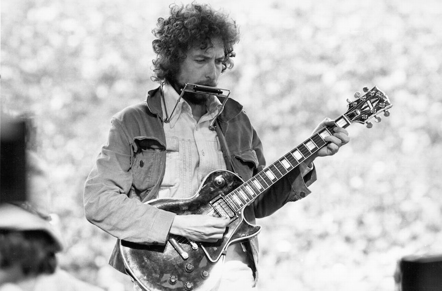 Bob Dylan performing at the Kezar Stadium in San Francisco, March 23, 1975. (Alvan Meyerowitz/Michael Ochs Archives/Getty Images)