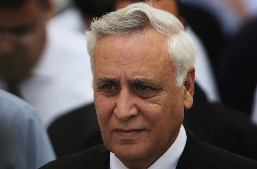 Moshe Katsav walking out from the Supreme Court in Jerusalem on November 10, 2011. Israel's Supreme Court on Thursday unanimously upheld the Tel Aviv District Court's decision to convict former President Moshe Katsav of two counts of rape and other sexual offenses, and to sentence him to seven years in prison. Photo by Kobi Gideon / Flash90.