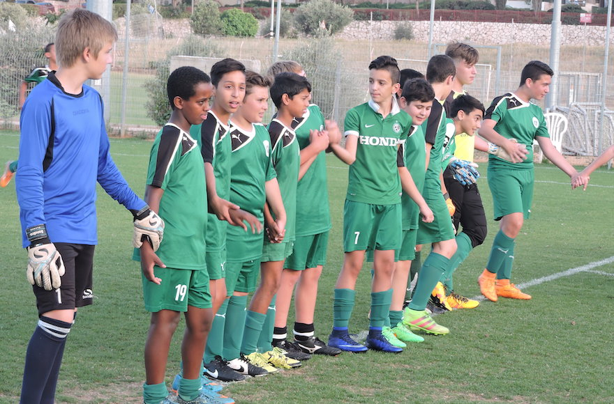 Members of the Tzav Pius 13-year-old team in the Israeli city of Pardes Hanna participate in an educational exercise meant to teach teamwork before a practice.  (Ben Sales)