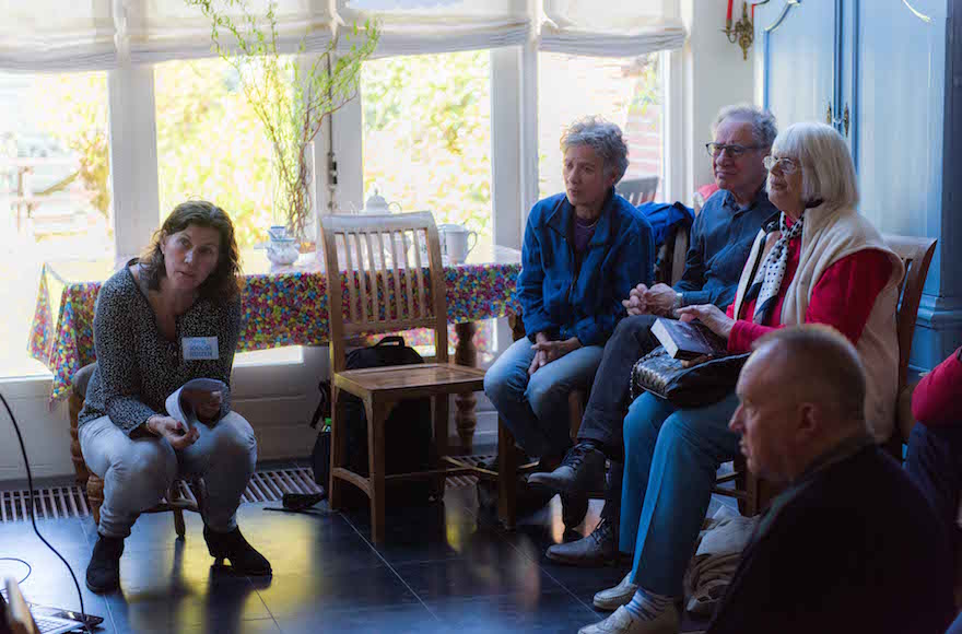 Yvonne van Gennep-Bouma, left, telling visitors about a Jewish family that once lived at what is now her home in the Hague, May 1, 2016. (Cnaan Liphshiz)