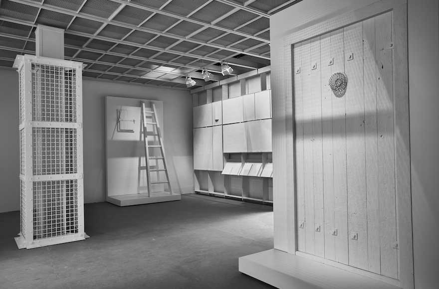 Interior of The Evidence Room at the Venice Architecture Biennale, with models of an Auschwitz gas column, a gastight hatch and a gastight door. (Fred Hunsberger)