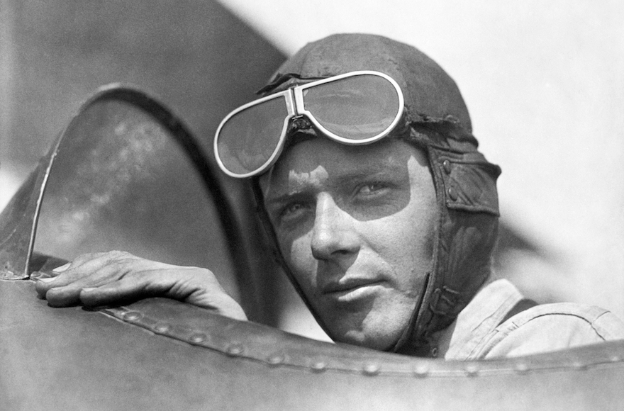 Charles Lindbergh, wearing a helmet with goggles up, in the cockpit of an airplane at Lambert Field, St Louis, Missouri, 1923. (Underwood Archives/Getty Images)