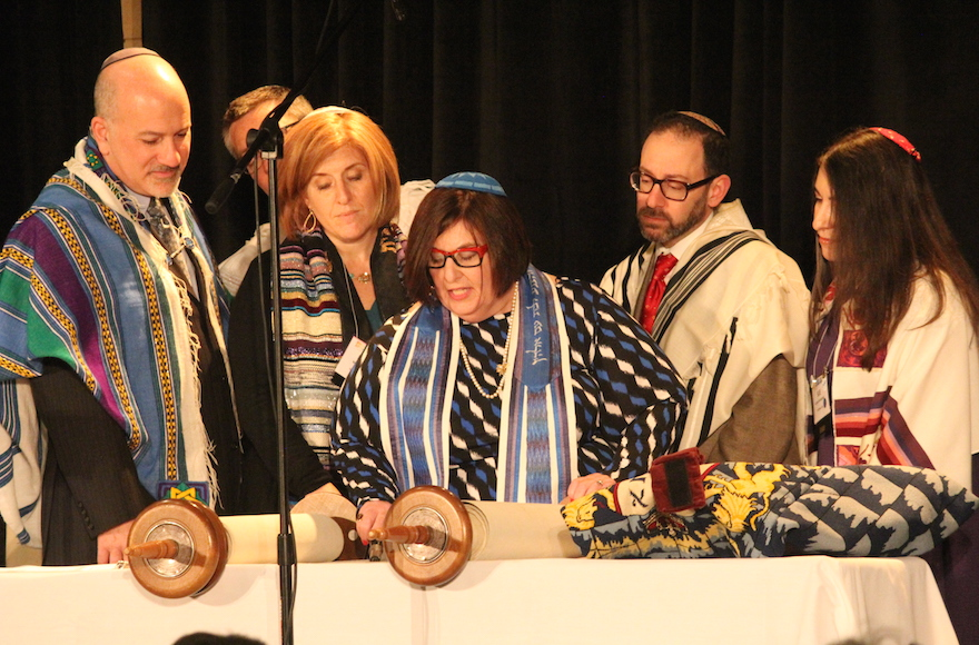 Rabbi Denise Eger, center, reading Torah during her installation as CCAR president, March 16, 2015. (David A.M. Wilensky)