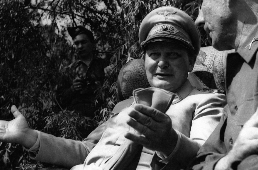 Hermann Goering speaking with a foreign journalist in his private garden in Augsburg , Germany, May 13, 1945. (Getty Images)