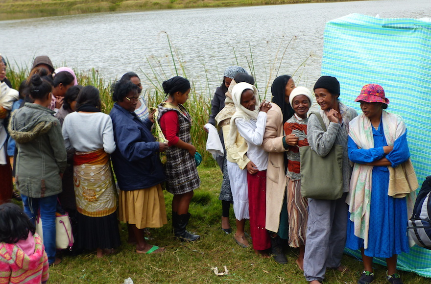 Malagasy women getting ready to immerse in the river before converting to Judaism, near Antananarivo, Madagascar, May 2016. (Deborah Josefson)