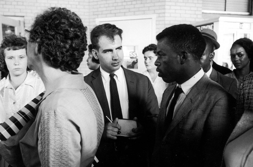 Writer Calvin Trillin, center, interviewing John Lewis in Birmingham, Ala., as the Freedom Riders were boarding the bus for Montgomery in 1961. (LIFE Images Collection)