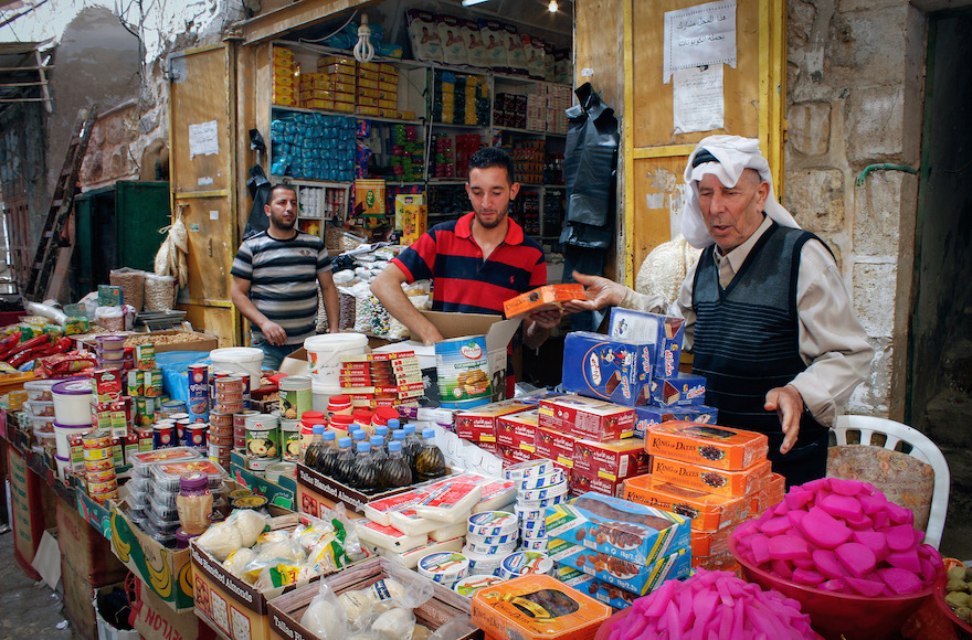 Palestinian vendors selling goods ahead of the holy month of Ramadan in the old city of the West Bank city of Hebron, June 5, 2016. (Wisam Hashlamoun/Flash90)