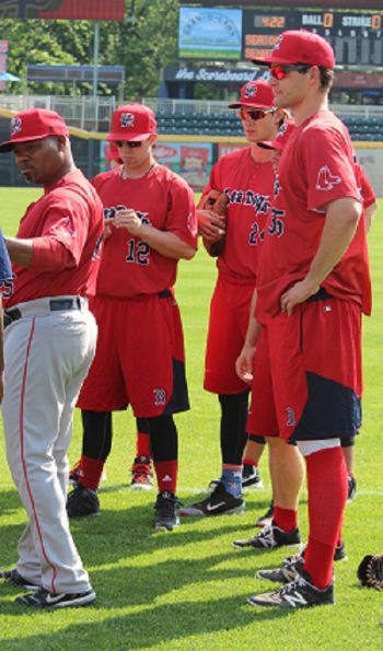 Nate Freiman, right, with some Portland Sea Dogs teammates and manager Carlos Febles, left, prior to a game, May 2016. (Hillel Kuttler)