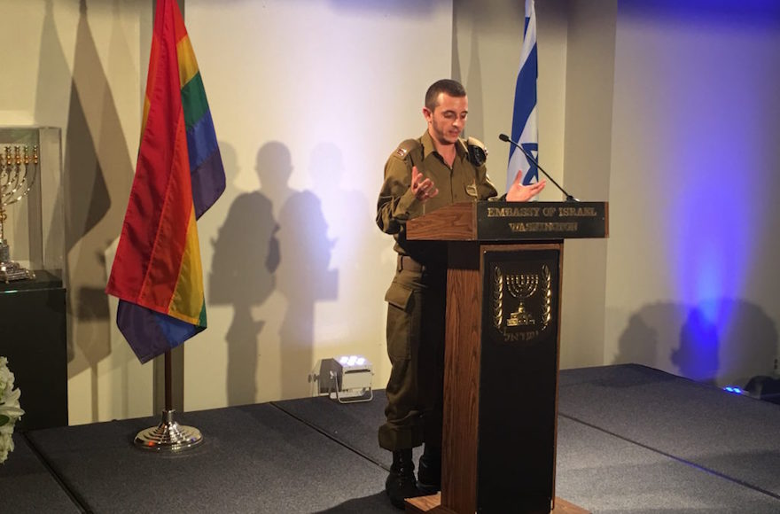 Lt. Shachar, Israel's first transgender officer, addressing a pride event at Israel's embassy on June 20, 2016. (Ron Kampeas)