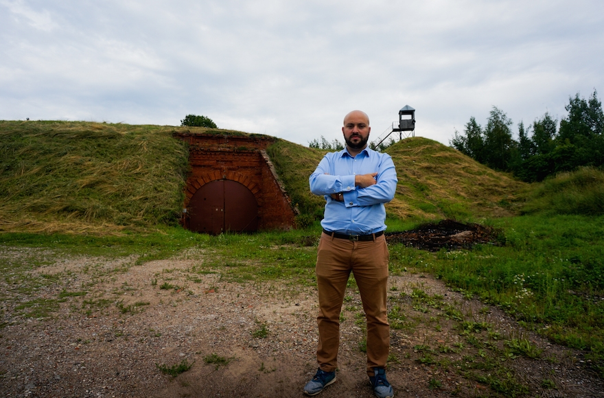 Jonny Daniels, founder of Poland-based Holocaust commemoration group From the Depths at the entrance to the Seventh Fort in Kaunas, Lithuania, on July 12, 2016. (JTA/Cnaan Liphshiz)