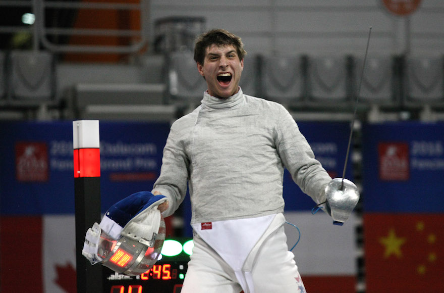 SEOUL, SOUTH KOREA - MARCH 26: In this handout image provided by the FIE, Eli Dershwitz of the USA celebrates his 12:9 victory over Iran's Mojtaba Abedini to win the individual Men's Sabre match during day 2 of the FIE Grand Prix on March 26, 2016 in Seoul, South Korea. (Photo by Mark Deibert/FIE via Getty Images)