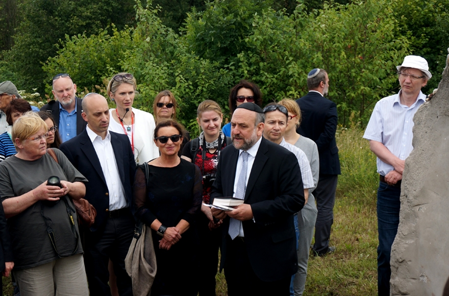 Michael Schudrich, Poland's chief rabbi, reciting a prayer for the victims of the Jedwabne massacre at the town's Jewish cemetery on July 10, 2016. (JTA/Cnaan Liphshiz)