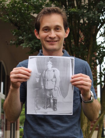 Baltimore jeweler Noam Efron holding a copy of the portrait he found of Siegfried Lamm at an estate sale for $9. (Hillel Kuttler)