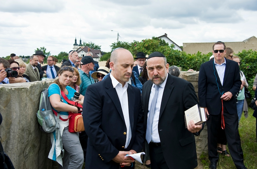 Jonathan Greenblatt, CEO of the Anti-Defamation League, confers with Rabbi Michael Schudrich, Chief Rabbi of Poland, during a ceremony commemorating the 75th anniversary of the massacre at Jedwabne. (Courtesy of the ADL)