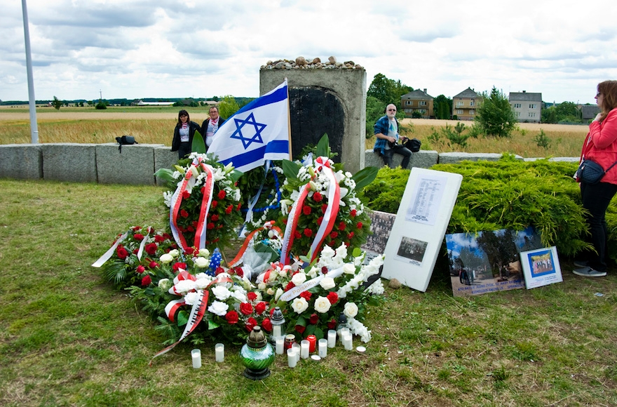 Flowers and wreaths left at the memorial to the massacre at Jebwabne.(Courtesy of the ADL)
