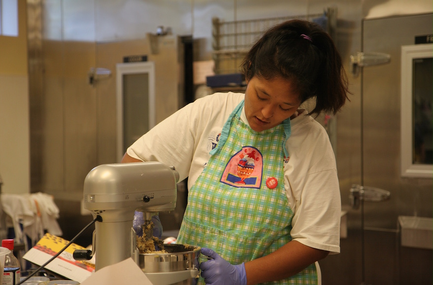 Kimberly Ferry, who had endured years of homelessness and mental-health struggles, working at the Altamont Bakery in Tulsa. (Courtesy of Congregation B'nai Emunah)