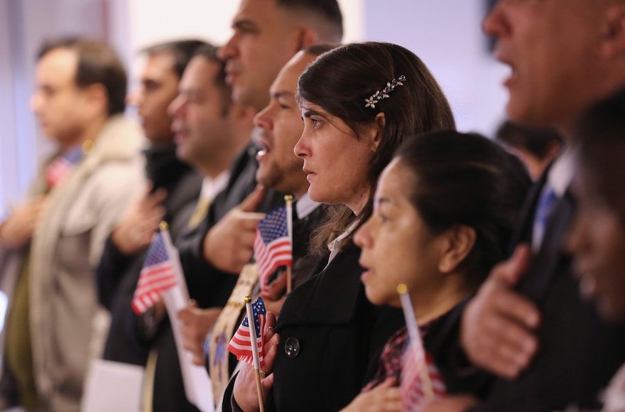 Immigrants take oath of citizenship