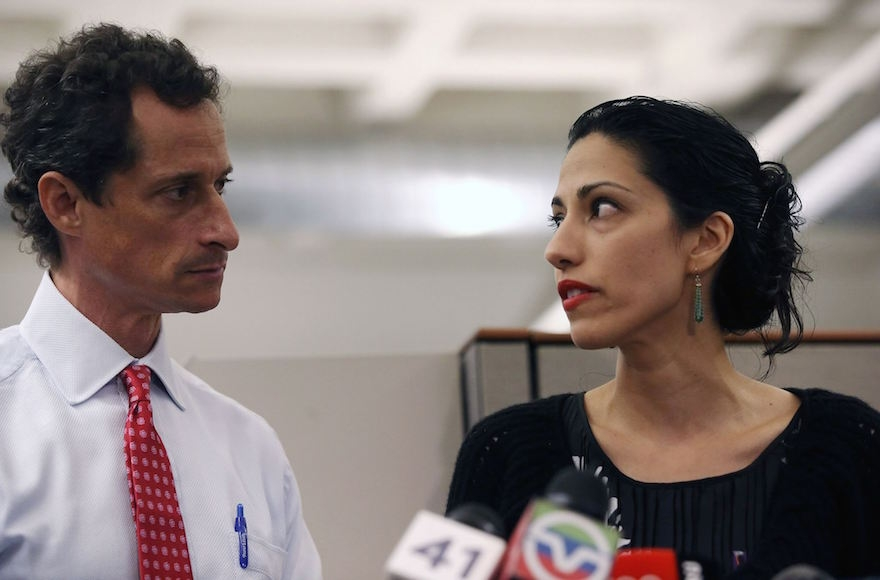 Anthony Weiner and Huma Abedin at a news conference in New York City at which Weiner acknowledged that he engaged in lewd online conversations with a woman after his resignation from Congress, July 23, 2013.(John Moore/Getty Images)