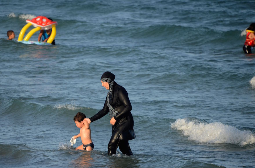 "A woman wearing a ""burkini"", a full-body swimsuit designed for Muslim women, at a beach near Bizerte, Tunisia, Aug. 16, 2016. (Fethi Belaid/AFP/Getty Images)"
