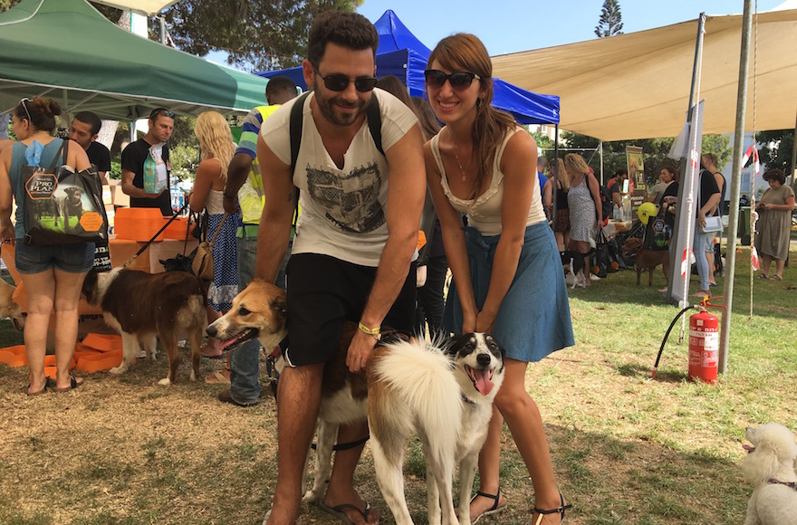 Hod Kashtan, left, with his dog Chuni, and Florencia Aventuriny with her dog Sandy at the Kelaviv dog festival in Tel Aviv, Aug. 26, 2016. (Andrew Tobin)