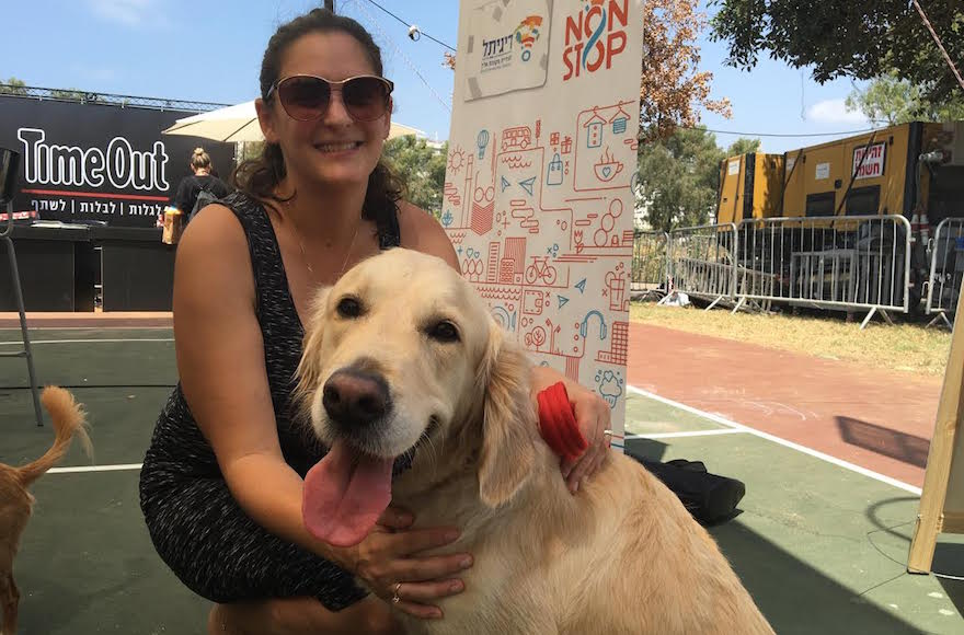 Mira Marcus, the city of Tel Aviv's director of international press, with her dog Shani at the Kelaviv dog festival in Tel Aviv, Aug. 26, 2016. (Andrew Tobin)
