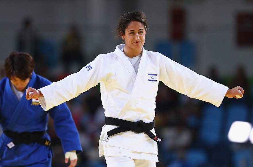 Yarden Gerbi of Israel celebrating victory over Miku Tashiro of Japan during the women's bronze medal judo bout on day four of the Rio 2016 Olympic Games at the Carioca Arena in Rio de Janeiro, Aug. 9, 2016. (Ryan Pierse/Getty Images)