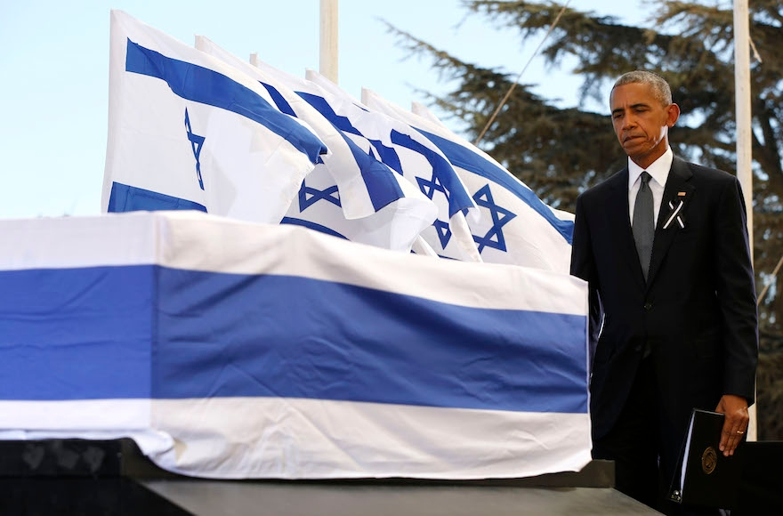 President Barack Obama touching the coffin of Shimon Peres after speaking during his funeral at Jerusalem's Mount Herzl national cemetery, Sept. 30, 2016. (Abir Sultan/AFP/Getty Images)