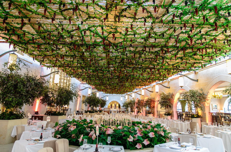 In 2015, this Studio Ya Ya-designed sukkah — one of four at the Waldorf Astoria Jerusalem — found inspiration in the atrium's existing flowers and water fountain. (Courtesy of Yarok Yarok Events Design)