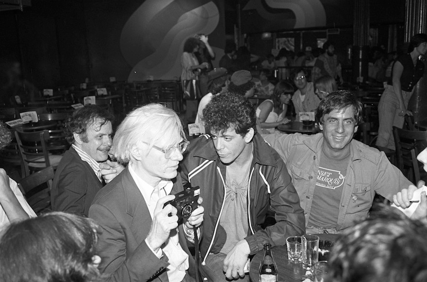 Danny Fields, right, with Andy Warhol, left, and Lou Reed, center, at a David Johansen show at the Bottom Line in New York City, July 20,1978. (Ebet Roberts/Redferns/Getty Images)