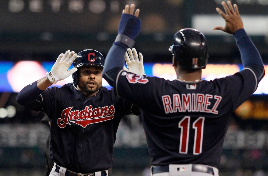 Coco Crisp, left, celebrating with teammate Jose Ramirez in a game against the Detroit Tigers at Comerica Park in Detroit, Sept. 26, 2016. (Duane Burleson/Getty Images)