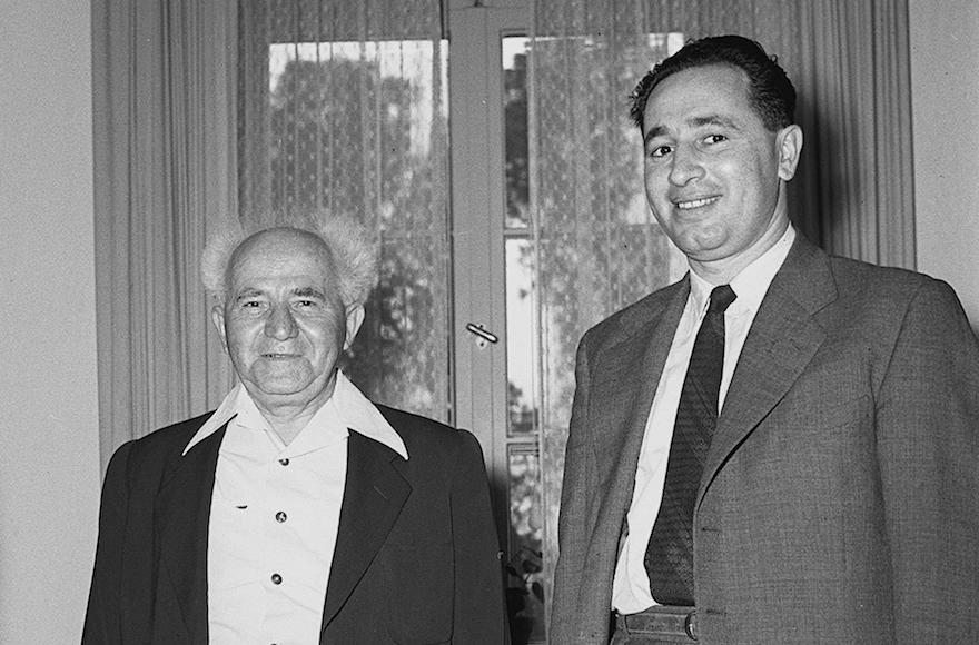 Shimon Peres, right, then Directer General of the Defense Ministry, with then Defense Minister David Ben Gurion in 1955. (GPO/Flash90)