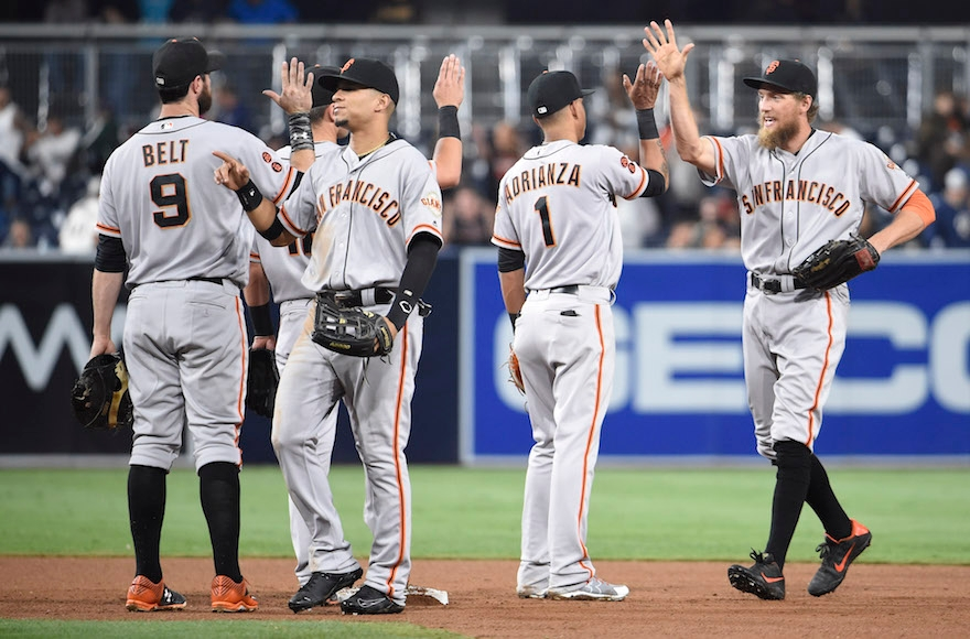 San Francisco Giants players celebrating a win against the San Diego Padres in a baseball game at PETCO Park, Sept. 22, 2016. (Denis Poroy/Getty Images)