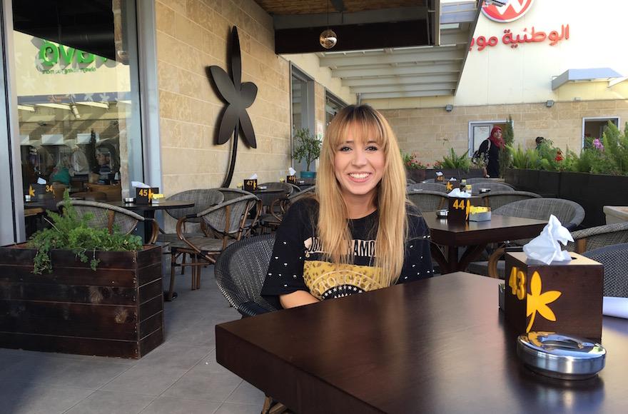 Hostess Nagla Aburous sitting at Jasmine Cafe before her shift in Nablus, West Bank, Sept. 18, 2016. (Andrew Tobin)