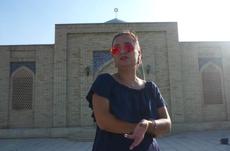 Shirin Yakubov standing in front of Bukhara's Jewish cemetery, Sept. 9, 2016. (Cnaan Liphshiz)