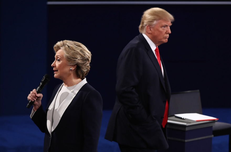 Hillary Clinton and Donald Trump participating at a town hall debate at Washington University in St. Louis, Oct. 9, 2016. (Win McNamee/Getty Images)