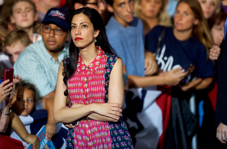 Huma Abedin waiting while Hillary Clinton greets supporters after holding a rally with Vice President Joe Biden at Riverfront Sports athletic facility in Scranton, Penn., Aug. 15, 2016. (Mark Makela/Getty Images)