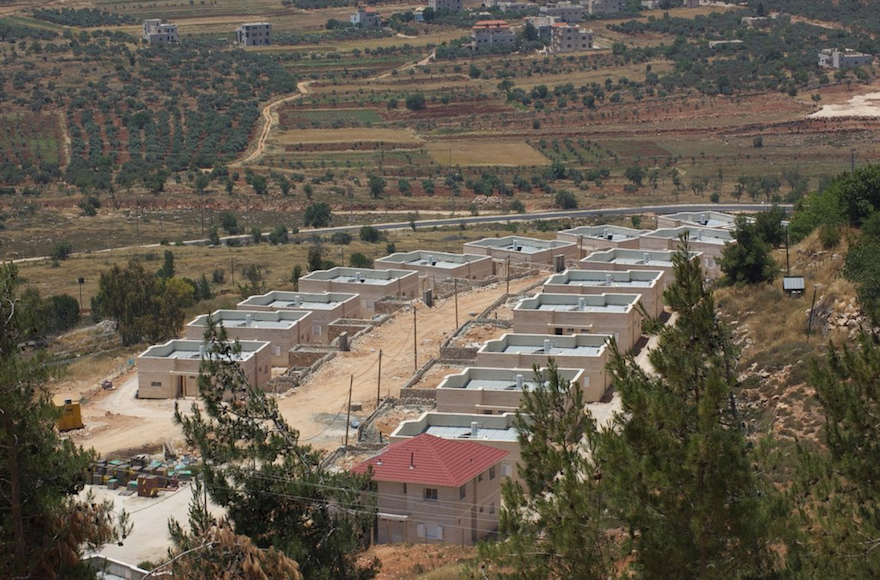 New houses being constructed in Shiloh, a Jewish settlement in the West Bank in 2013. (Ryan Simon via CC)