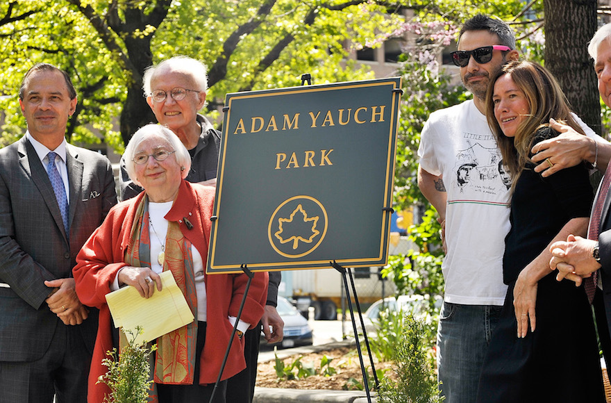 Noel and Frances Yauch, second from left, and former Beastie Boys member Adam Horovitz and wife Rachael, with New York City and Brooklyn officials standing by the plaque marking Adam Yauch Park in Brooklyn, May 3, 2013. (Daniel Zuchnik/Getty)