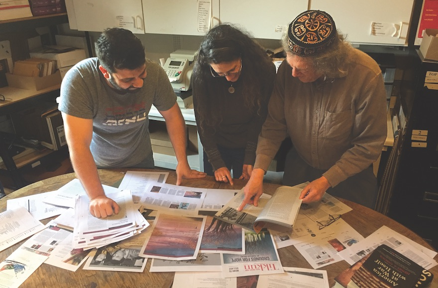 Ari Bloomekatz, Cat Zavis and Rabbi Michael Lerner working on a recent issue of Tikkun. (Courtesy of J. Weekly)