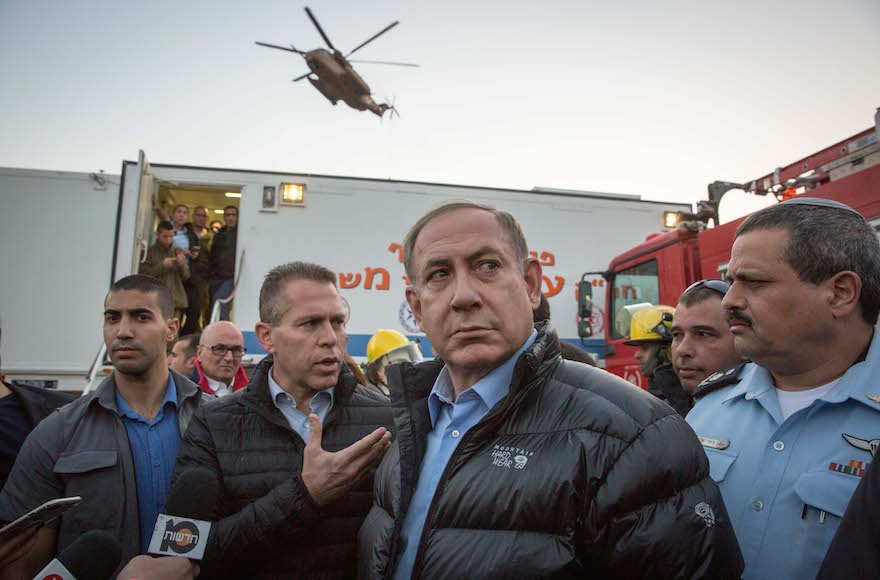 Prime Minister Benjamin Netanyahu visiting the scene of a fire at Zichron Yaakov in northern Israel, Nov. 23, 2016. (Emil Salman/Pool)