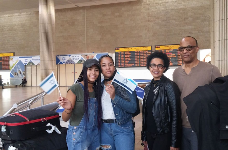 George and Amy Camara and two of their four children arriving in Israel on Nov. 2, 2016. (Courtesy of the International Fellowship of Christians and Jews)