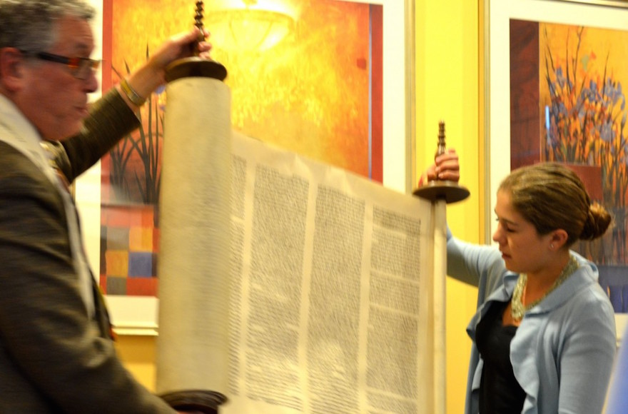 Charlotte Smith and Rabbi Jerry Levy at the dedication of the family Torah scroll rescued by her great-great-grandfather, at AlmaVia, a senior residence community in San Rafael,California, Oct. 2012. (Julie Ann Kodmur)