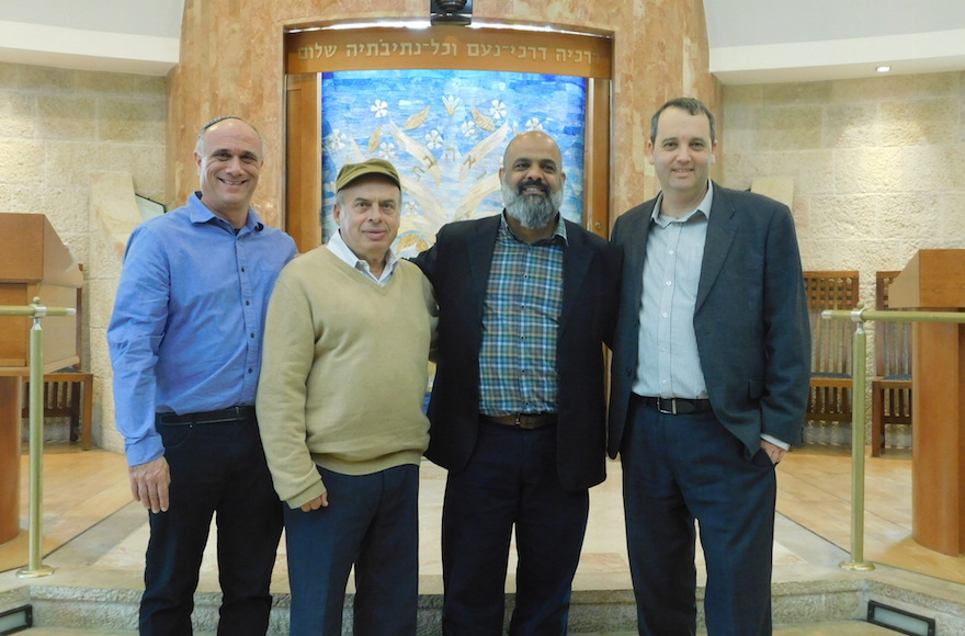 Jewish Agency Chairman Natan Sharansky, second from left, with Rabbi Daniel Meyer, far left, Yossi Cohen, center right, and Israel Movement for Reform and Progressive Judaism Executive Director Rabbi Gilad Kariv, far right, at Kehillat Ra'anan – Beit Samueli in Raanana, Israel, November 30, 2016. Hate graffiti and death threats were discovered on Nov. 24, 2016. (Adi Romem, Beit Samueli – Kehillat Ra'anan via Jewish Agency for Israel)