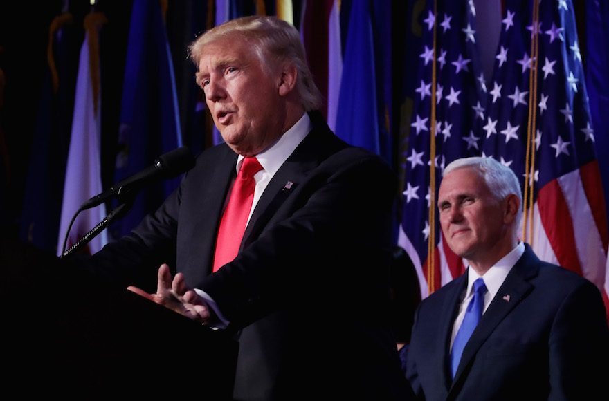 Republican president-elect Donald Trump delivering his acceptance speech as Vice president-elect Mike Pence looks on during his election night event at the New York Hilton Midtown in New York City, Nov. 9, 2016. (Chip Somodevilla/Getty Images)