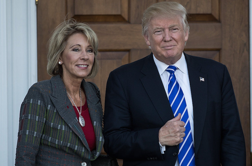 Betsy DeVos and president-elect Donald Trump outside the clubhouse at Trump International Golf Club, in Bedminster Township, N.J., Nov. 19, 2016 (Drew Angerer/Getty Images)