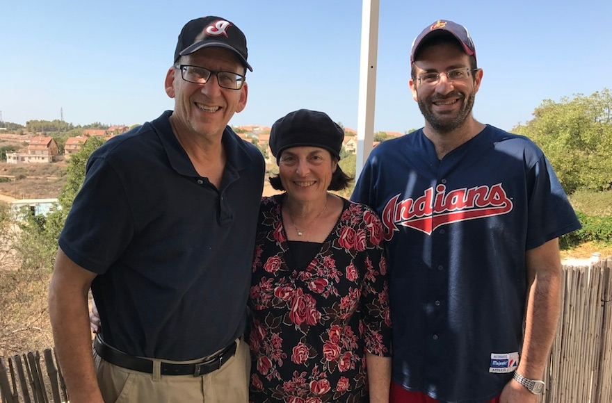 Doug Mandel (left), iris Mandel and Mitch Mandel posing at their house in the West Bank settlement of Karnei Shomron, Oct. 28, 2016. (Andrew Tobin)
