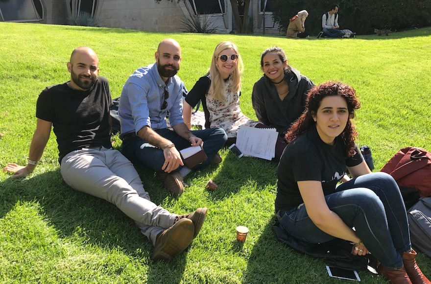 From left: Maor Seri, Ahmed Fahoum and friends hanging out on the Hebrew University of Jerusalem's Mount Scopus campus, Nov. 6, 2016. (Andrew Tobin)