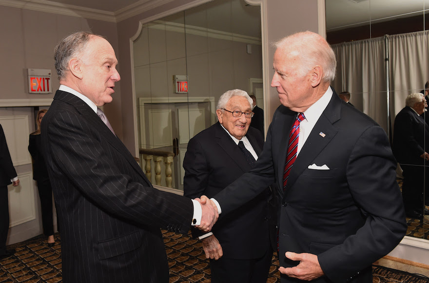 Vice President Joe Biden, right, shaking hands with World Jewish Congress President Ronald Lauder, as former Secretary of State Henry Kissinger looks on, at the Pierre Hotel in New York City, Nov. 9, 2016. (Shahar Azran/WireImage/World Jewish Congress)